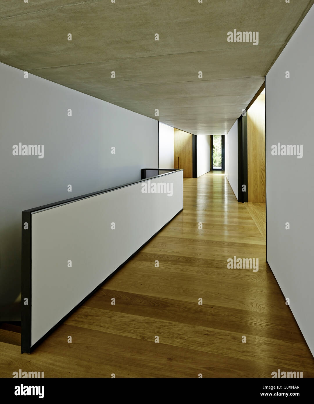 View Of Contemporary Minimally Decorated Hallway With Black And   Half Wall Staircase Design   Minimalist   Stair Railing   Frames Up   Architecture Contemporary   Stairway
