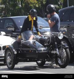 selma blair takes a ride in a sidecar of a vintage bmw motorcycle with a male [ 1300 x 1338 Pixel ]