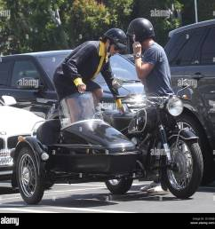 selma blair takes a ride in a sidecar of a vintage bmw motorcycle with a male [ 1300 x 1287 Pixel ]