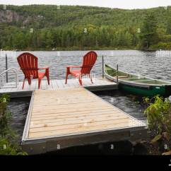 New River Adirondack Chairs Transfer Shower Chair Two Red On Floating Dock Stock