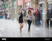 Two Women Running Street In Leicester Uk