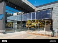 modern office building exterior with solar panels above