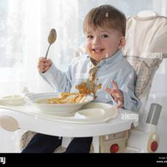 Eating Chair For Toddlers Hardwood Dining Chairs Toddler Boy Sitting In A High Soup With
