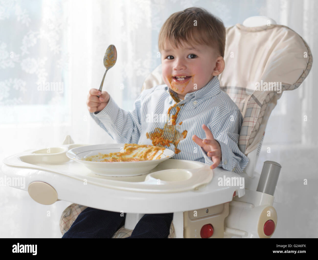 Baby Chair For Eating Toddler Boy Sitting In A High Chair Eating Soup With A