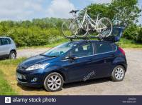 A Ford Fiesta car carrying two bikes on a roof rack Stock ...