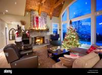 Christmas tree in living room with fireplace, North ...