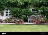 Flower pots on a cottage garden patio. Ashton Under Hill ...