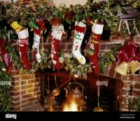 1960s CHRISTMAS STOCKINGS HANGING ON FIREPLACE MANTLE WITH ...