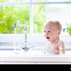 Kitchen Sink Baby Bath Tub Best Lighting Taking In Child Playing With Foam And Soap Bubbles Sunny Bathroom Window Little Boy Bathing