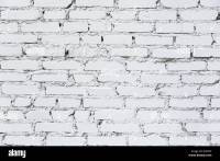 weathered white painted brick wall texture as background ...
