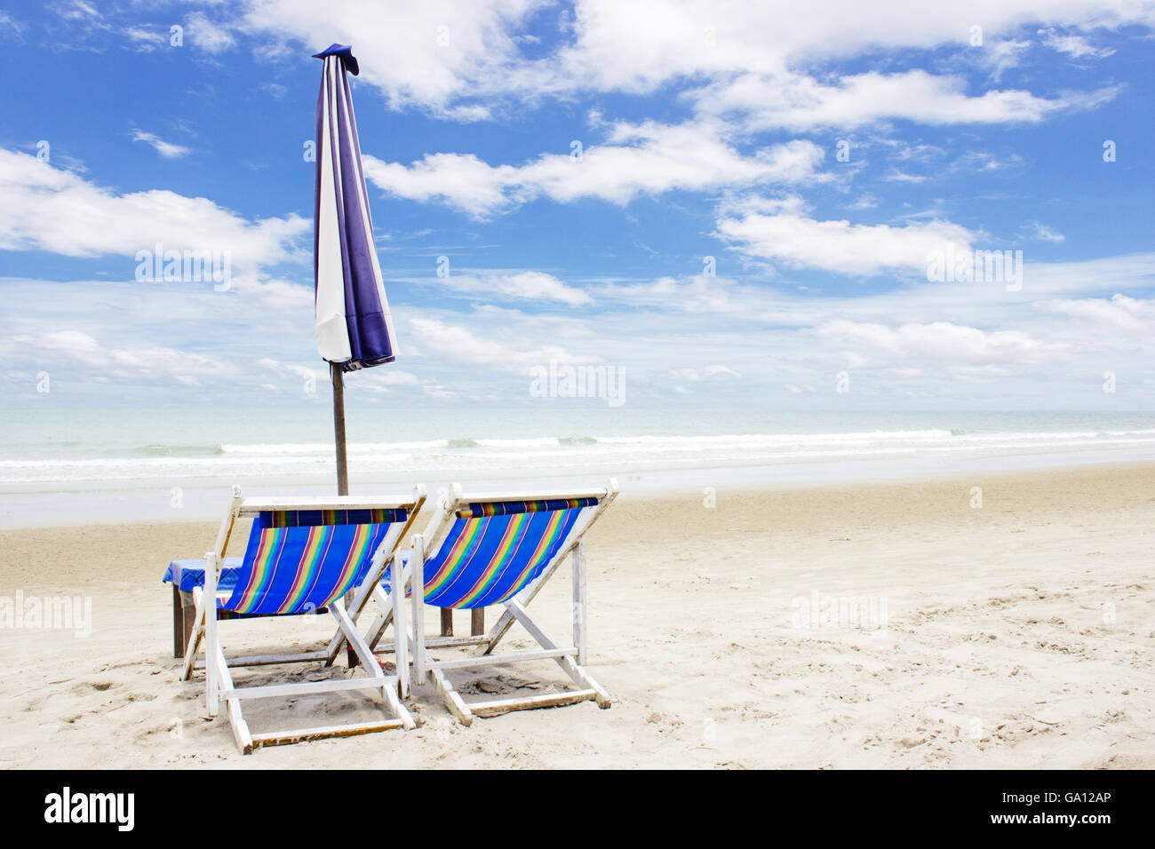 Beach Lounge Chairs Two Beach Lounge Chairs And Tent On Beach And Blue Sky Background