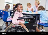 Disabled Child In Wheelchair Stock Photos & Disabled Child ...