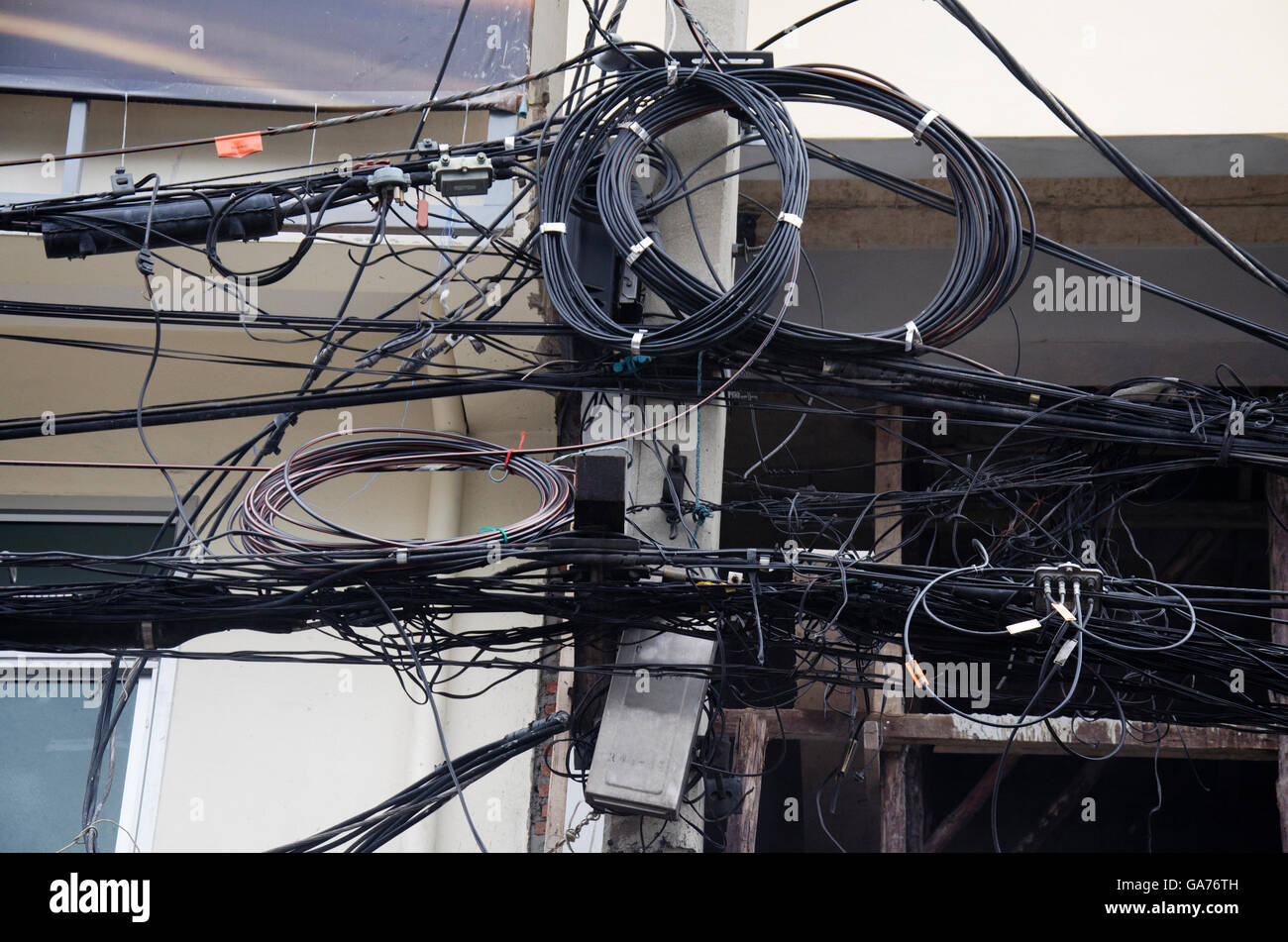 hight resolution of many wires messy with power line cables transformers and phone lines on old electricity pillar or utility pole at beside road a