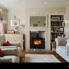 Cosy Living Room With Log Burner Wooden Units Cottage Sitting Wood Burning Stove And Linen Stock Upholstered Sofa