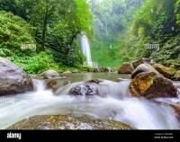A large waterfall on the beautiful tropical Island of Bali ...
