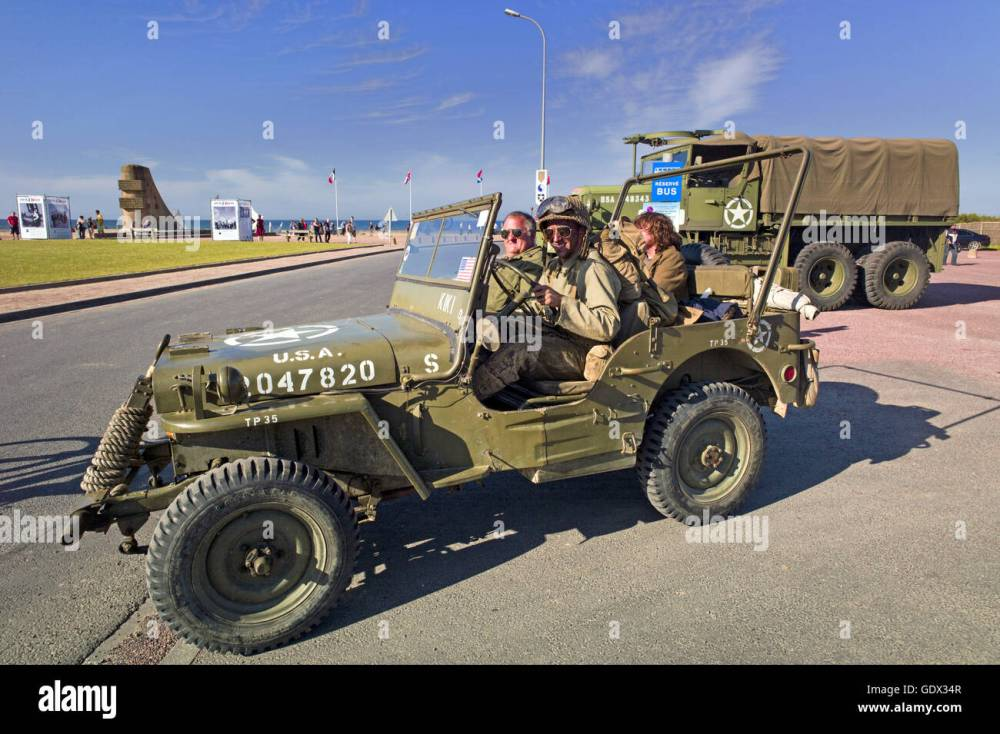medium resolution of soldiers in a willys us army jeep in saint laurent sur mer france 2014
