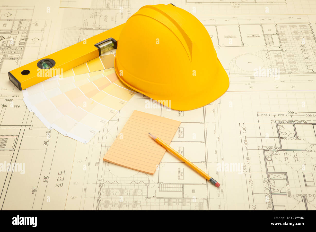 hight resolution of objects related to construction such as floor plan tool helmet color code diary and pencil