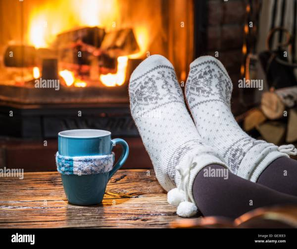 Cup Of Hot Coffee In Front Fireplace Stock - Year of Clean Water