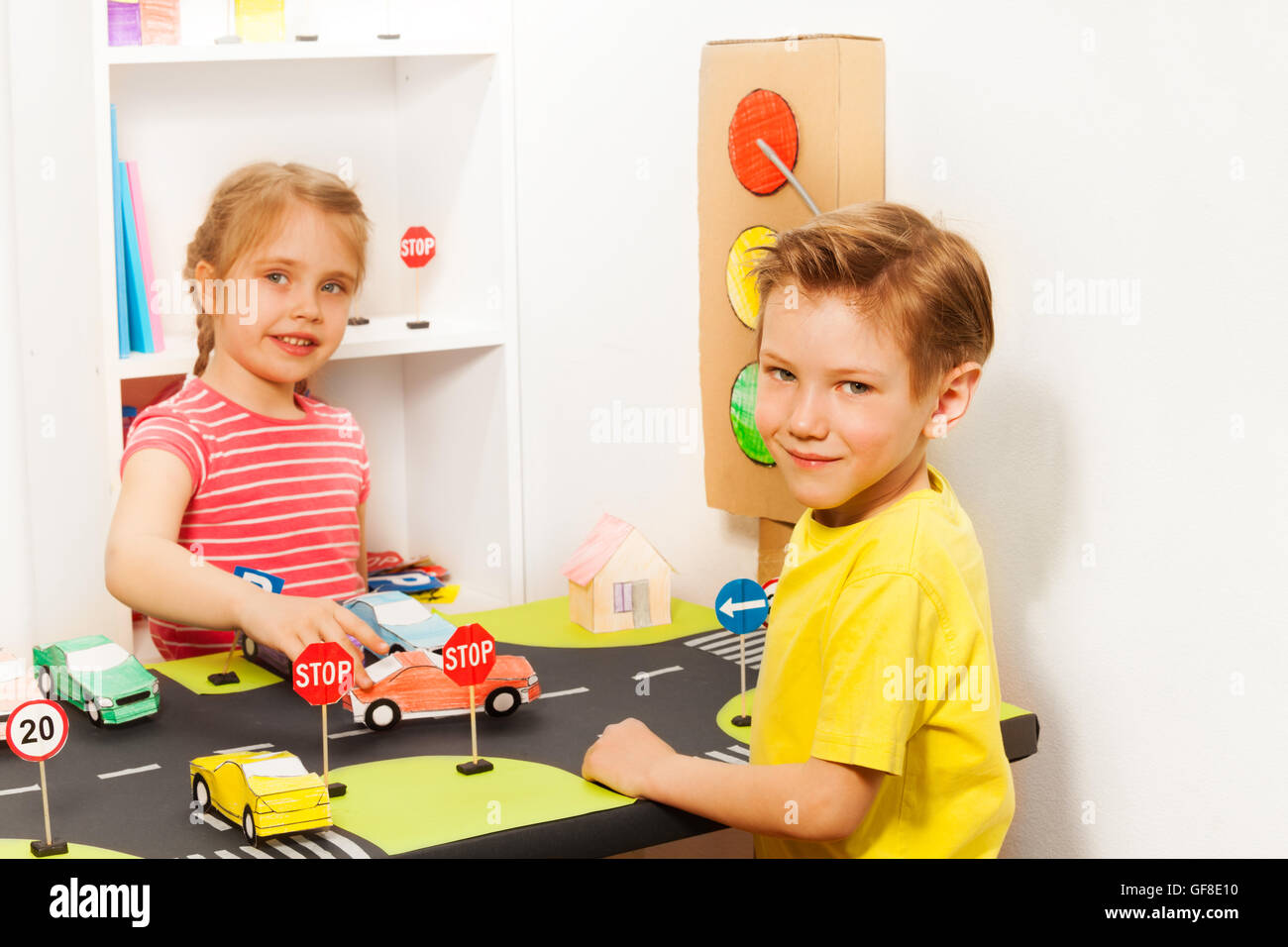 Preschool Boy And Girl At The Road Safety Lesson Stock