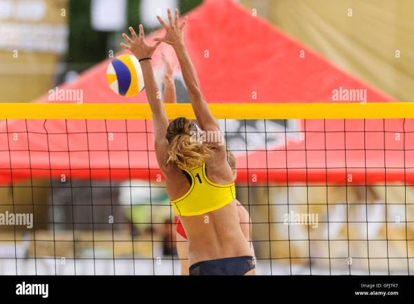Girl Spiking Volleyball Stock &