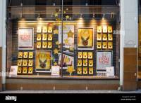 A bookstore window displays advertising for the latest ...
