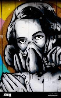 Street art wall mural graffiti of woman wearing oxygen gas ...