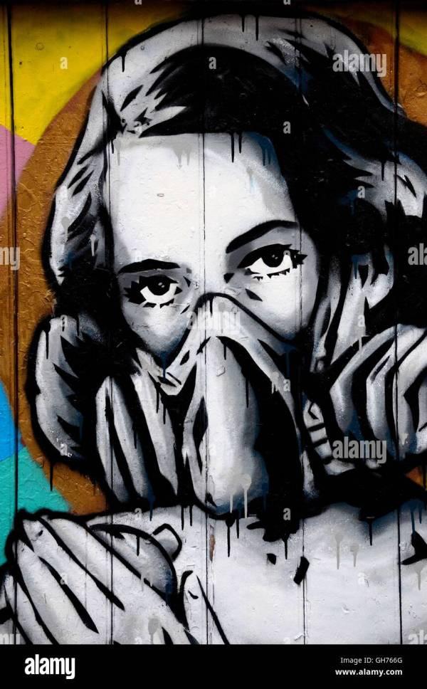 Street Art Wall Mural Graffiti Of Woman Wearing Oxygen Gas Mask Stock 113869912 - Alamy