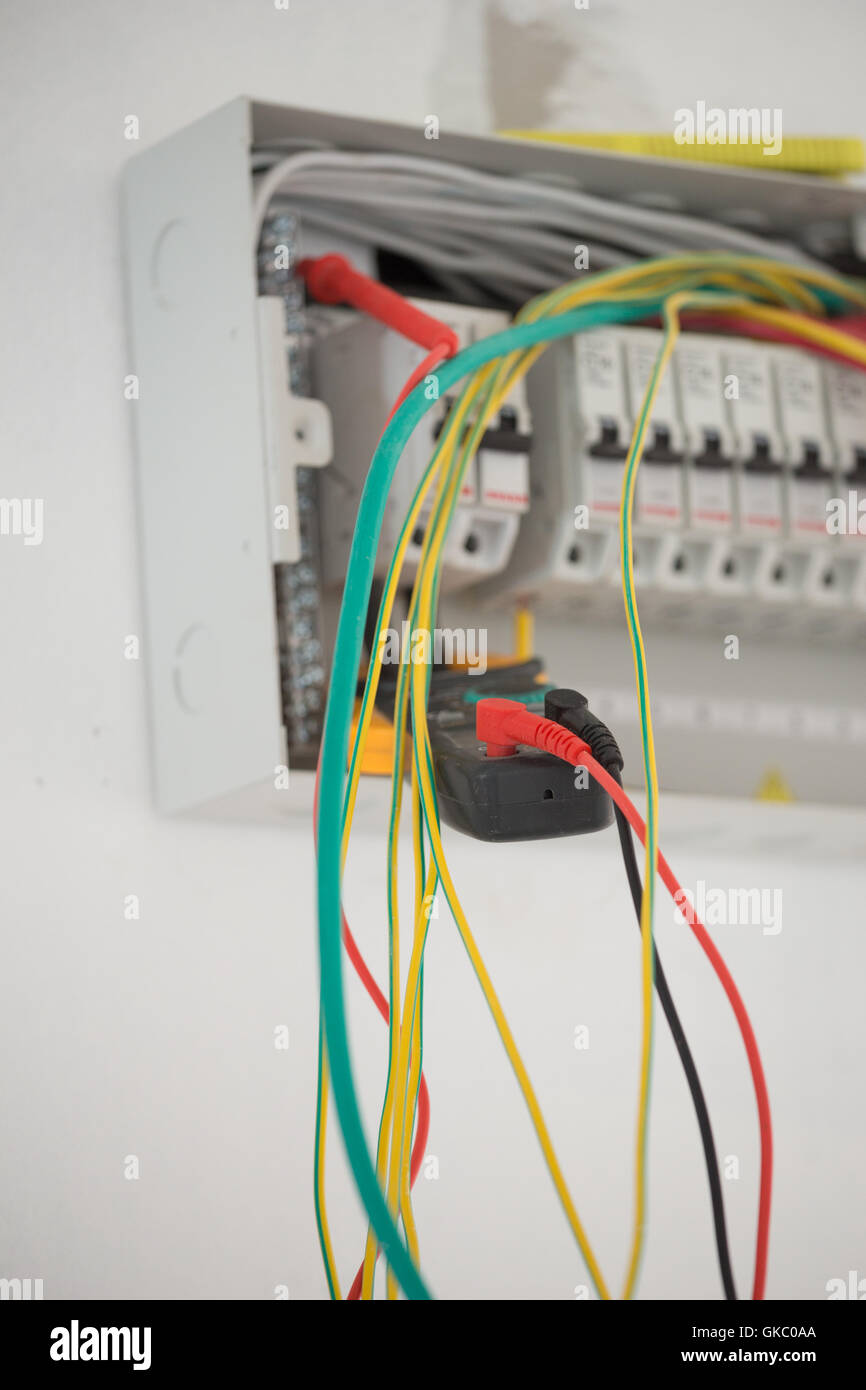 medium resolution of electrical measurements in new cabinet with multimeter stock image domestic fuse box