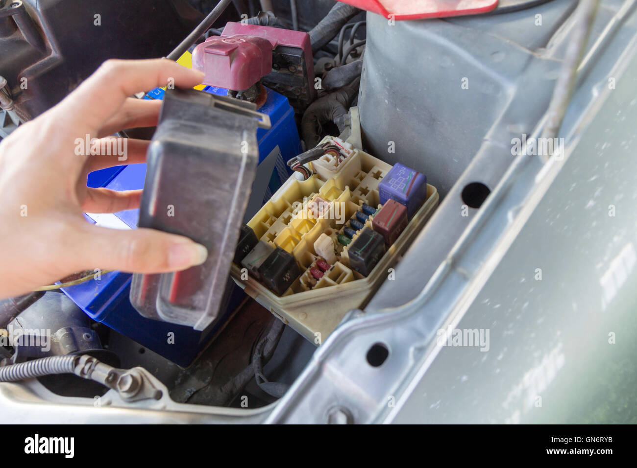hight resolution of the man opening fuse box of old car stock image