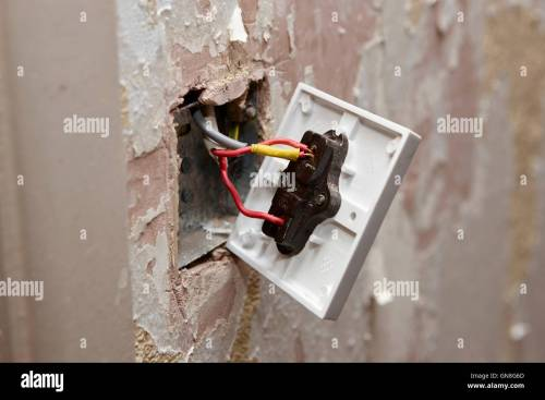 small resolution of bare wiring on back of light switch in house being redecorated in the uk