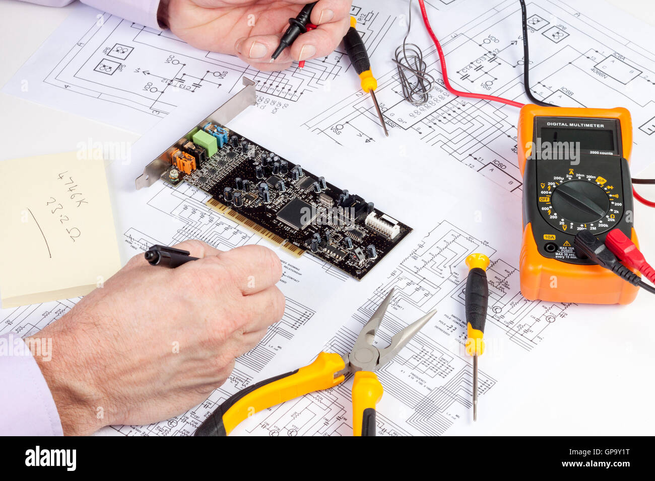 hight resolution of electronics engineer making changes to a computer circuit wiring diagram