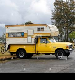parked 1990 s yellow ford f250 pickup truck with a camper in vancouver british columbia  [ 1300 x 953 Pixel ]