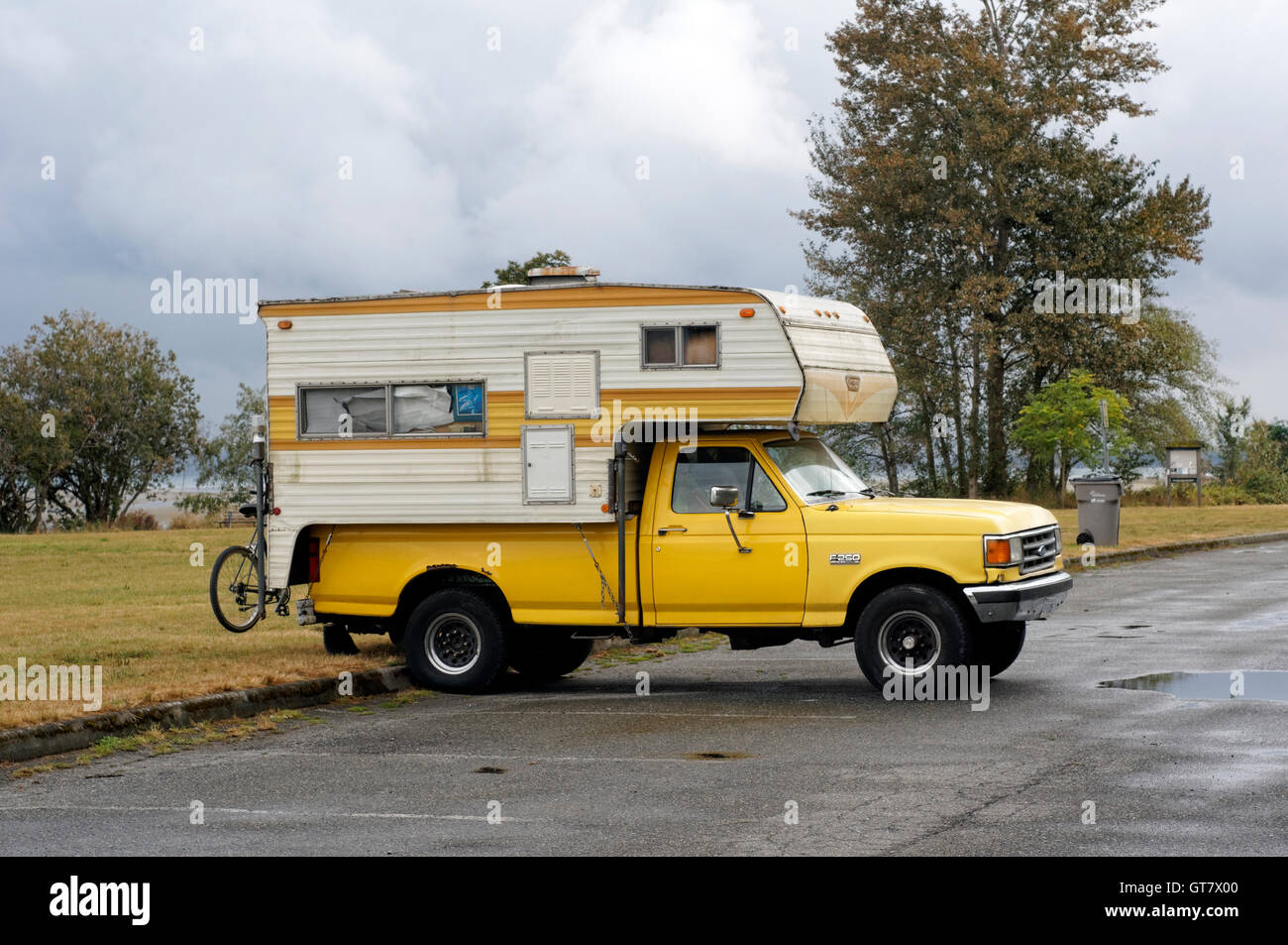 hight resolution of parked 1990 s yellow ford f250 pickup truck with a camper in vancouver british columbia