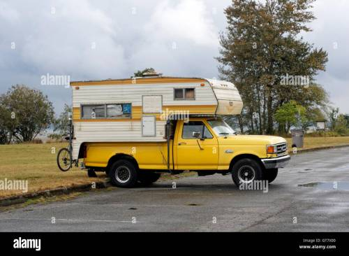 small resolution of parked 1990 s yellow ford f250 pickup truck with a camper in vancouver british columbia