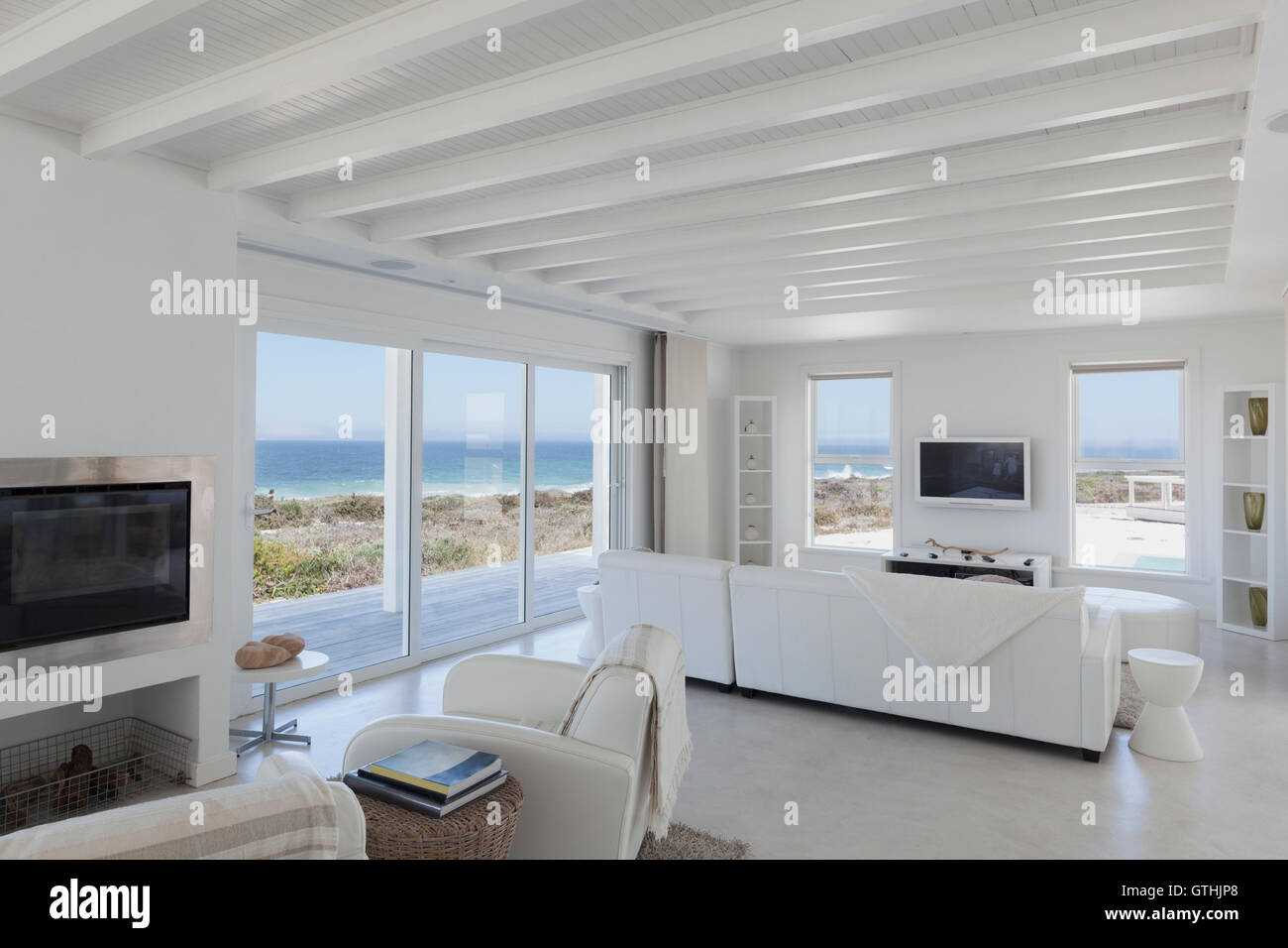 Beach house living room with wood beam ceilings Stock