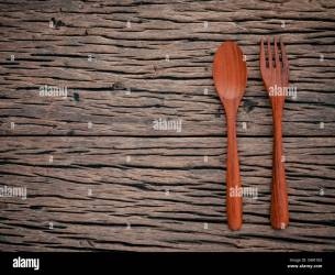 Fork and spoon on grunge wood food background concept menu design Stock Photo Alamy