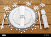 Christmas dinner table setting with white porcelain plates ...