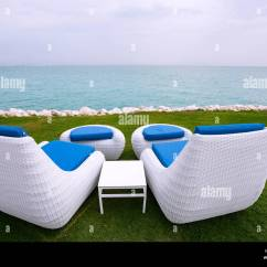 Folding Chair Qatar Step2 Table And Chairs Two White Sun Loungers Beside The Sea In Doha Stock Photo