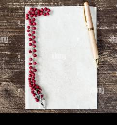 catholic rosary and pen on blank paper sheet with copy space stock image [ 1300 x 956 Pixel ]
