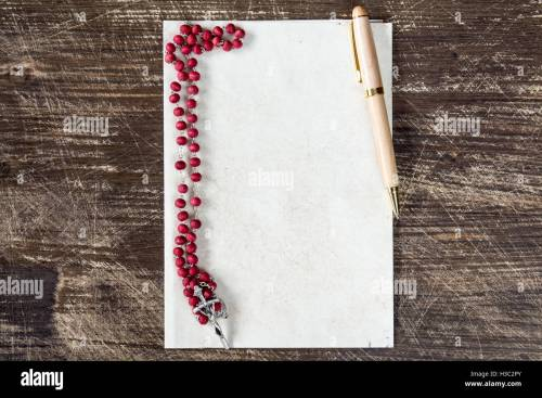 small resolution of catholic rosary and pen on blank paper sheet with copy space stock image