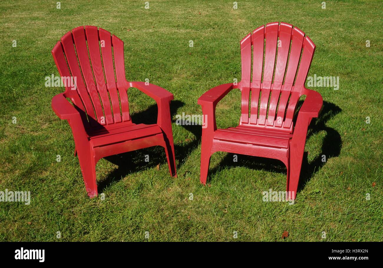 Red Adirondack Chairs Two Red Adirondack Chairs In The Grass Stock Photo 122841901 Alamy