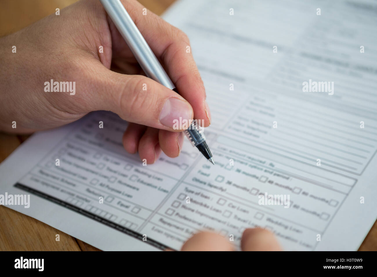 Businesswoman Filling Last Will And Testament Form - Stock Image