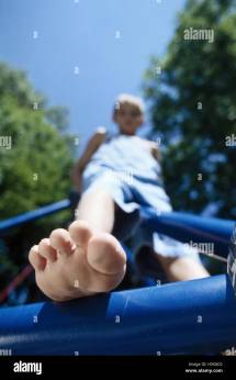 Climbing Frame Boy Barefoot Close