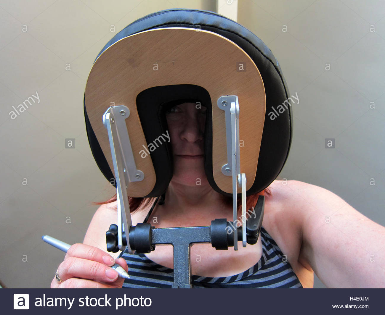 Woman seen from below in face down position in chair