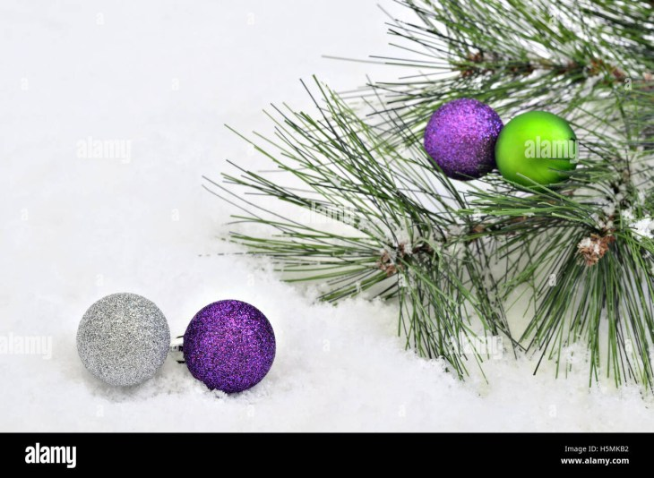 Christmas tree balls with fir sprigs on snow background, close up, space  for text, horizontal, full frame