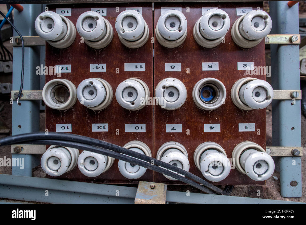 hight resolution of an old fuse panel with ceramic fuses from east germany seen in the former people s swimming pool in the district of lankow in schwerin germany