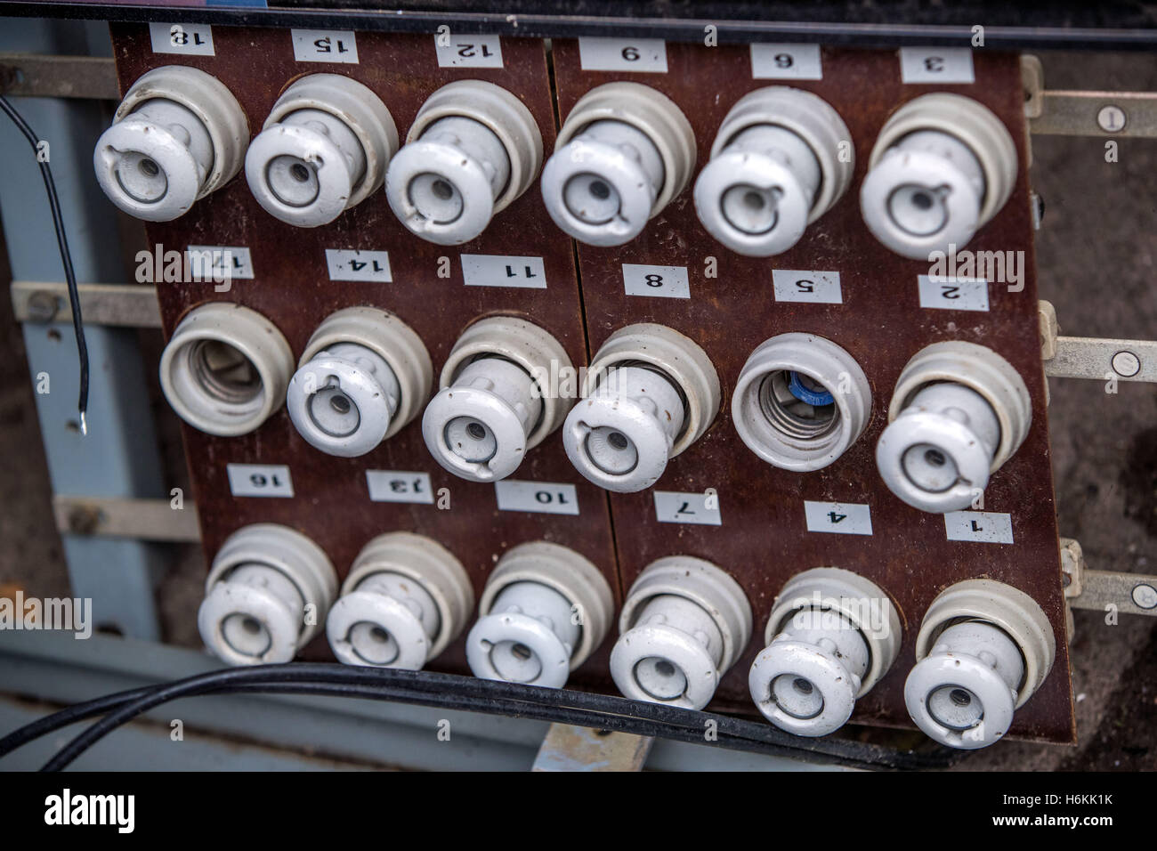 hight resolution of an old fuse panel with ceramic fuses from east germany seen in the former people s