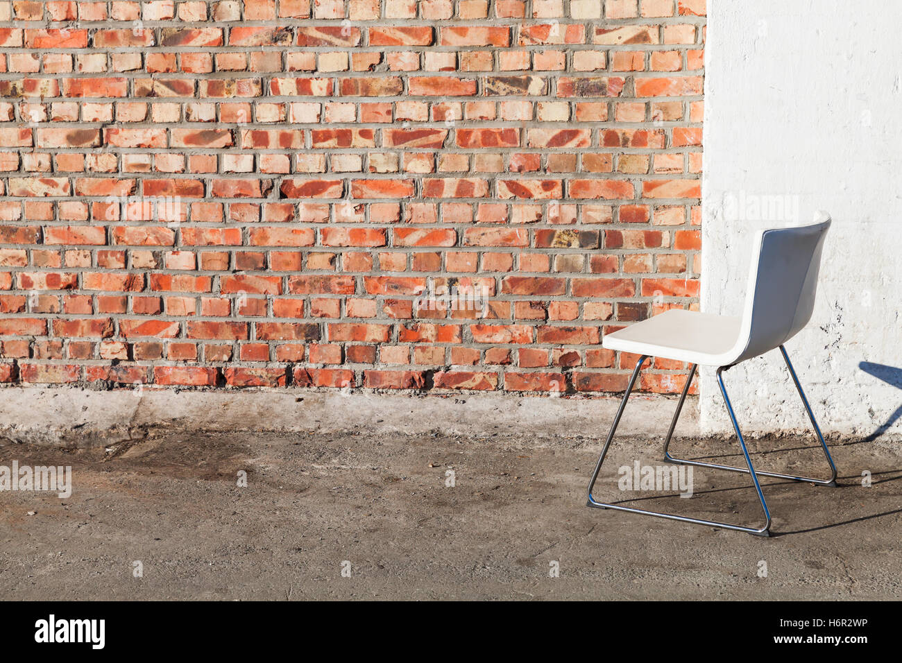 chair stands on baby chairs at walmart abstract empty interior background white office gray concrete floor near red brick wall