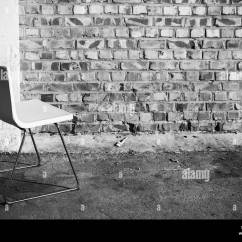 Chair Stands On Pottery Barn Napoleon Abstract Empty Interior Background White Office Concrete Floor Near Brick Wall Black And Photo
