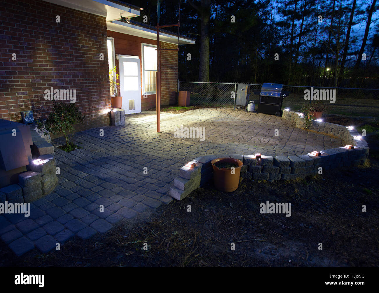 https www alamy com stock photo large patio with sand set bricks and solar lights in the night 125789148 html